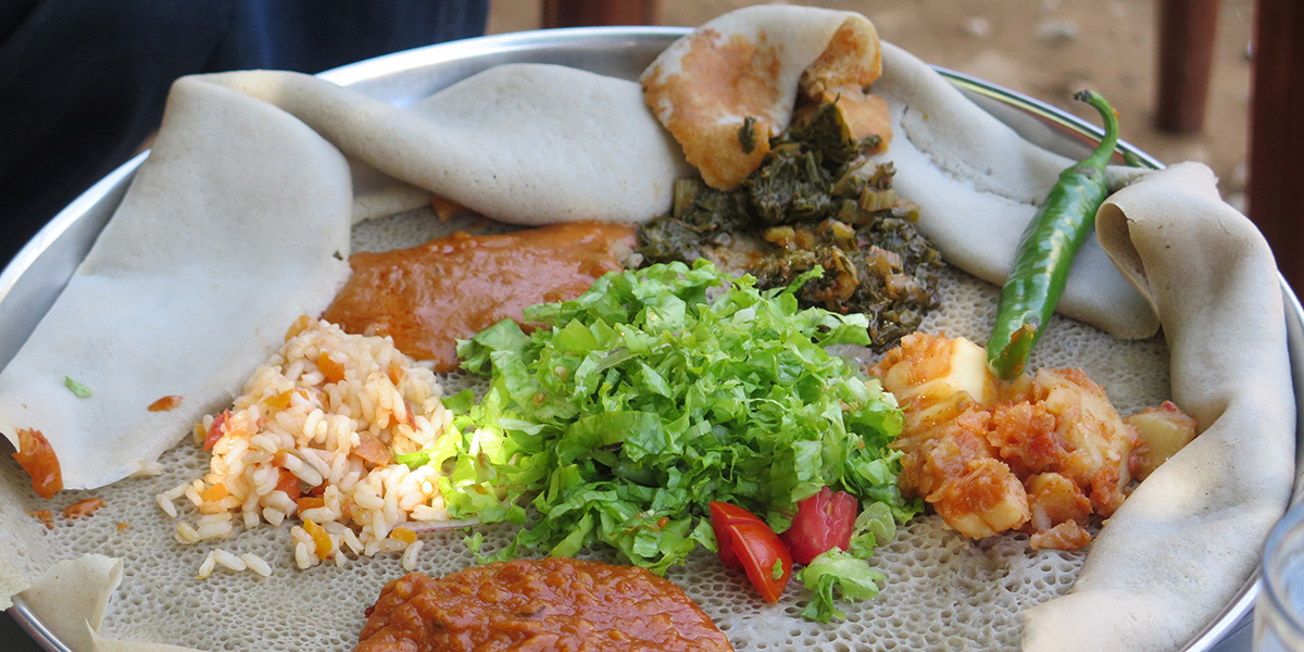An Ethiopian meal laid out on flat-bread